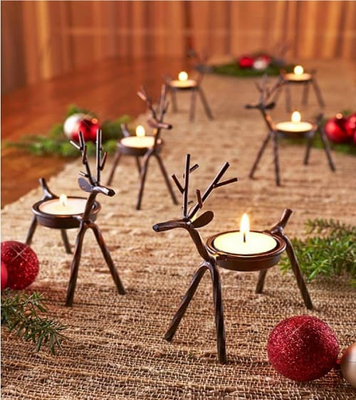 Reindeer Candle Holders made from iron with a rustic bronze finish - Set of 6, so you can group them together on your fireplace mantel or use them on your Christmas dinner table
