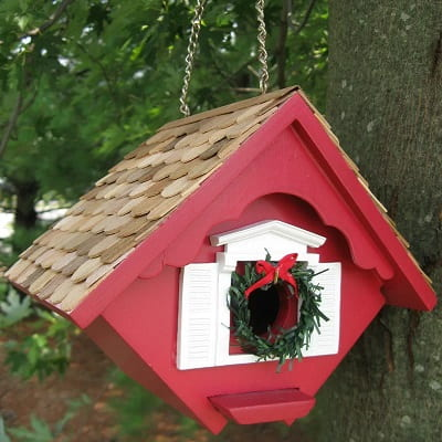 Red Holiday Birdhouse with Christmas Wreat at the entryhole